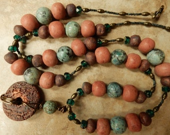 Contemporary earth bound necklace... urban primitive ....At Home In Taos beads and wire wrapped  pendant, .... truly one of a kind..