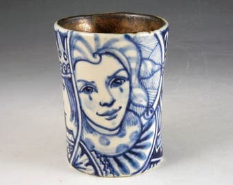Blue white and gold porcelain story cup with queen, jester and the word Imagine
