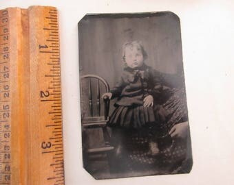 antique tintype - little girl with chair on someone's lap