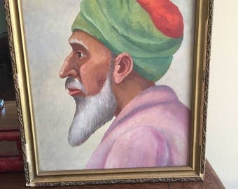 Old portrait on board. Man, profile , turban