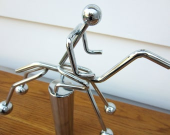 Large silver motion jockey on horse.  Desk accessory.