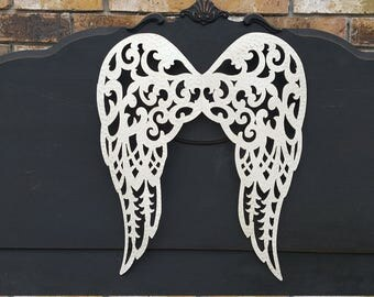 White metal wings to hang on your wall or front door.  Perfect for a little girls room