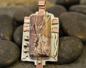 sterling silver dendritic rhyolite pendant with copper accents.
