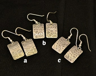 sterling silver textured earrings.  choose a, b or c.  Each earring 3/4 x 1/2 in.