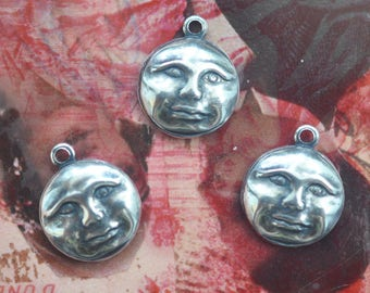TWELVE Face Brass Charms, Sterling Silver Finish