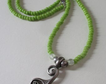 Triskelion necklace with green glass and jade 22""