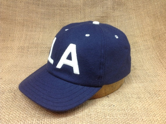 Wool flannel 6 panel cap with custom felt logo. Any letters available. Fitted to any size.