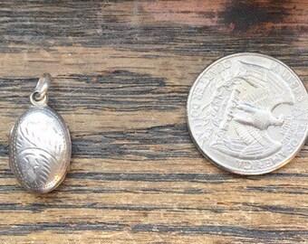 Sterling silver engraved oval locket