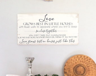 Love grows best in houses just like this quote. Painted on barnwood.