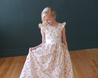 Floral print flower girl dress with diamante sash and butterfly sleeves