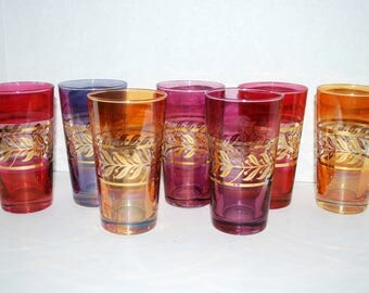 Mid century multicolor glasses with  gold accents   heavy base smooth pontil hand blown glass