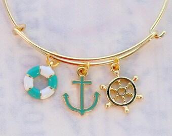 Beach charm bangle, aqua green white and gold boating charm bangle, ship steering wheel, ocean anchor, life preserver charms, sea jewelry