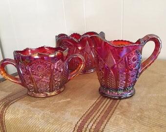 Red carnival glass bowl and cream sugar