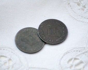 Two Missouri Sales Tax Receipt Tokens