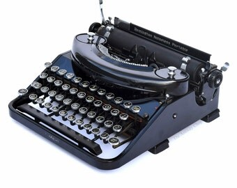 Remington Noiseless Portable Typewriter Professionally Refurbished Portable w/Two New Ribbons & New Feet