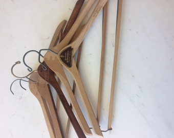 five old wooden hangers