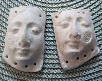 Two ready-to-finish white earthenware talisman faces