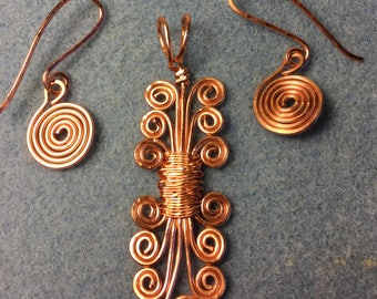 "Simple Copper Wire Swirled Pendant, on Black Satin Cord with matching earrings, very unique.  Pendant is 2 1/2"" long"