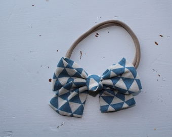 blue and ivory triangle fabric bow on nylon headband (one size fits most)