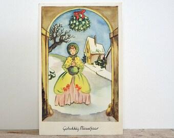 CHRISTMAS POSTCARD - lady with yellow jacket, mistletoe, snow landscape, vintage retro greetings post card, paper ephemera, season cards