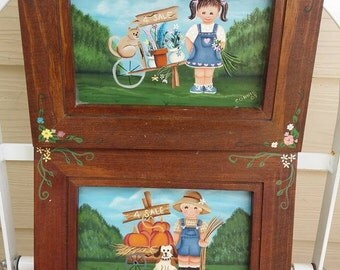 set of two hand painted girl and boy wood frames