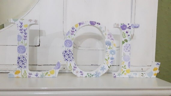 Gorgeous spring floral covered LOL free standing wooden decoupaged letters. 15 cm high