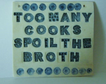 Porcelain Wall Sign - Too Many Cooks Spoil the Broth.
