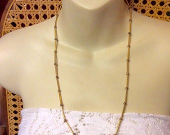 Vintage Les Bernard gold metal tube chain and metal beads necklace. 1960s