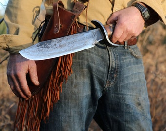 Large Bowie Knife with leather sheath.