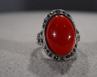 vintage silver tone ring with large red oval smooth lucite stone surrounded with round gray rhinestones, size 9  M2