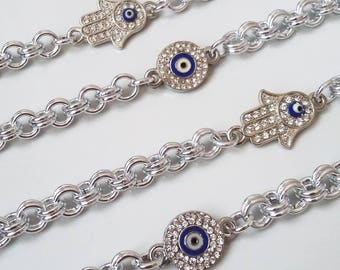 Chainmail bracelet with hamsa and greek eye