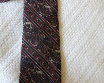 "Keys and Lockwood men's necktie, 54 1/2"" long and 3"" at widest point, rust, black, burgandy, tan, accessory, prof. cleaned"