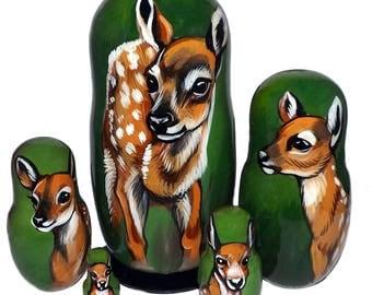 Baby Deer on Five Russian Nesting Dolls. Wild Life.