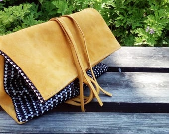 Suede and leather clutch with long tassel