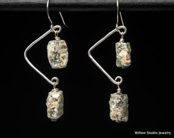 Old Glitter, earrings made of solid sterling silver wire hung with ancient glass overlaid with extra patina, hand forged and quite unusual