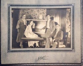 Sepia toned family photo circa 1940's, from the Johnson Studio, Akron, Ohio.