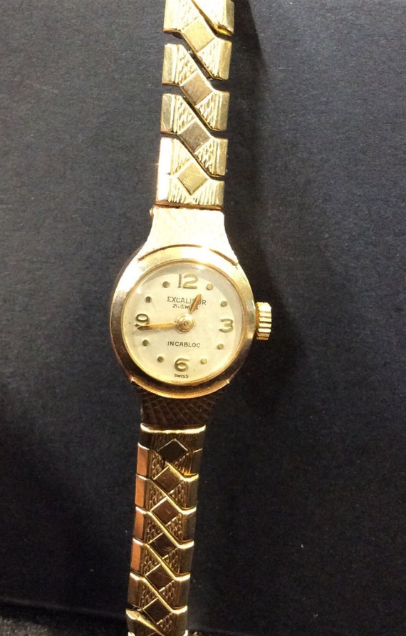 Gold Excalibur ladies watch on expanding bracelet