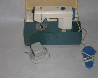 Vintage child's sewing machine portable case small electric foot peddle Crystal Japan plastic