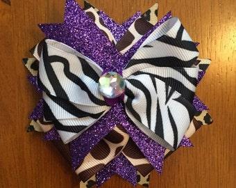 Purple, leopard, zebra, and giraffe hair bow