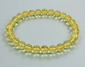 Round beads genuine Baltic amber  bracelet .