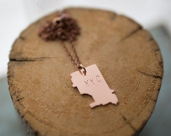 Hand sawn, copper Calgary stamped YYC necklace from Alberta