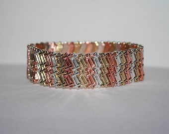 Beautiful Vintage Tri Color Elastic bracelet. Never been worn! 7.25 inches