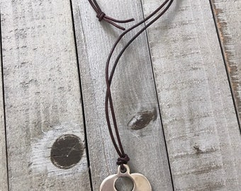 Leather cord necklace with silver pendant