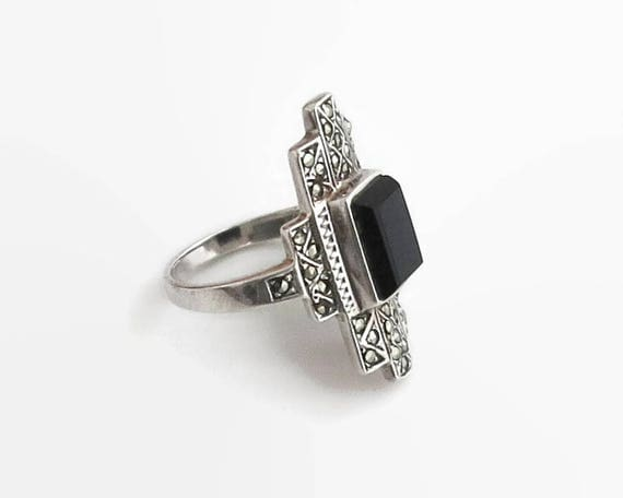 Sterling silver marcasite and onyx ring, Art Deco style, onyx in raised bezel setting, stamped 925, 6 grams, size M.5 / 6.5, circa 1970s