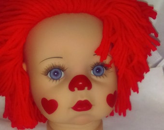 Large Clown Doll Head, He or she has bright red hair perfect for a bigger clown doll.