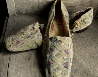 shabby antique straight sole shoes for display