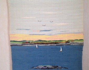 A hand-woven scene showing a sunset in the beautiful Bohuslän in Sweden from 70s