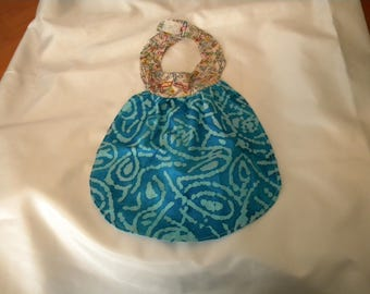 Babybib - newborn   Pins on beige collar w/blue batik