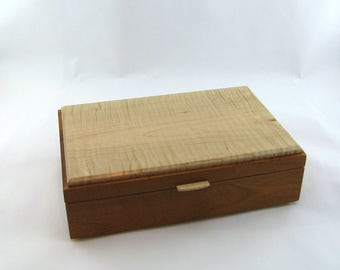 Tea box in Mahogany on the side 12 X 7 3/4 x 3 1/2.Top is made from figured Maple
