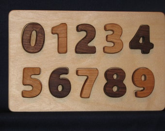 Wooden Number Puzzle, easy for little hands to grip and learn.